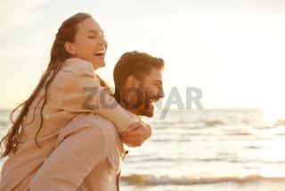 happy couple having fun on summer beach