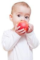 Baby girl eating healthy food isolated