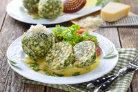 Hearty spinach dumplings with salad