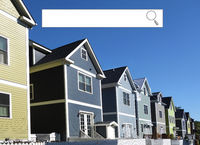 Internet search window and neighborhood street with new homes