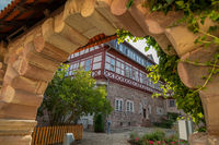 View through an archway to a historic half-timbered house in Wasungen