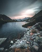 Blue lake Spiegelsee Mittersee waldsee and distant mountain range Dachstein in Austrian Alps