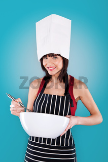 Brunette woman cooking