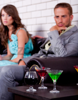 Annoyed young couple in bar or night club