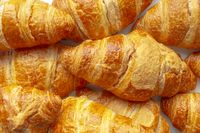 Several Croissants, crescent shape and, like other viennoiserie, are made of a layered yeast-leavened dough.