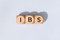 IBS word on woden blocks isolated on gray background