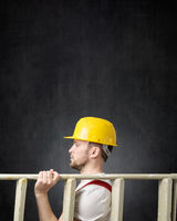 Portrait of a construction worker with ladder