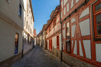 Narrow cobbled alley with facades of half-timbered houses in Meiningen