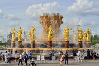 Moscow, Russia - august 25, 2020: tourists walk near the fountainFriendship of Peoples, the main fountain and one of the main symbols of VDNKh