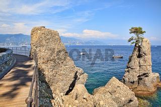 Wooden footbridge along Mediterranean sea coast in Portofino.