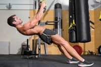 Fitness Man Doing Functional Training At Gym.