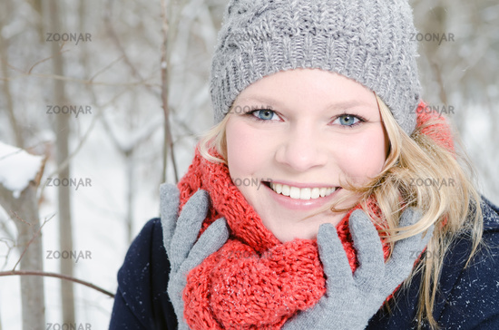 young blonde woman with cap and scarf Winterwald Portrait