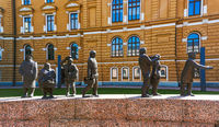 view of the Ajan Kulku bronze statues commemorating the city history of Oulu in the park in front of the city hall