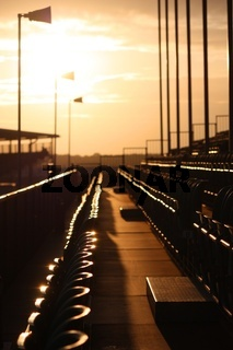 Rows of seats in a grandstand at dusk