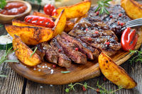 Barbecue meal with beef steak