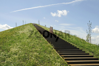 Steep stairs leading on a heap at Lake Phoenixsee on the grounds of the former steelworks Hermannshuette
