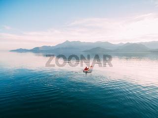 Kayaks in the lake. Tourists kayaking on the Bay of Kotor, near