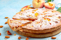 Open pie with peaches and frangipane.