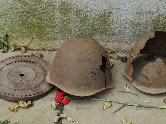 Old soldiers' iron helmets with holes