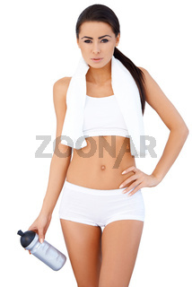 Cute sporty girl standing over white