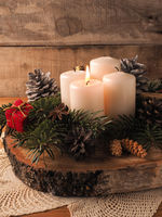First Advent candle burning, traditional Christmas decoration