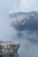 foggy valley with cliff rock