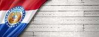 Missouri flag on white wood wall banner, USA