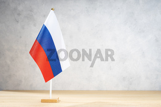 Russia table flag on white textured wall. Copy space for text, designs or drawings