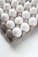 Vertical view of a Package Cardboard Egg Holder Egg Tray with eggs