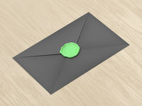 Envelope sealed with green wax