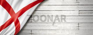 Alabama flag on white wood wall banner, USA
