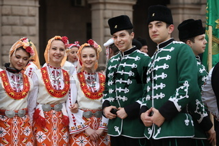 People in traditional folk costumes perform the Bulgarian folk dance 'Horo'