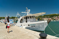 Excursion boat in the port of the town of Rab on the coast of the Adriatic Sea in Croatia