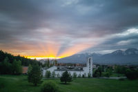 sunset at the church in Svit with the rays of the sun