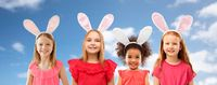 happy girls wearing easter bunny ears headbands