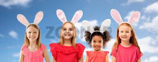 happy girls wearing easter bunny ears headbands