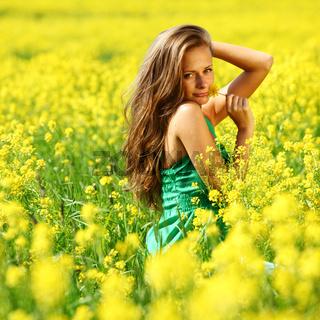 woman on oilseed field close portrait