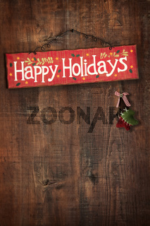 Bright holiday sign on wooden wall