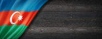 Azerbaijani flag on black wood wall banner