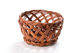 decorative wicker basket on a white background with soft shadow