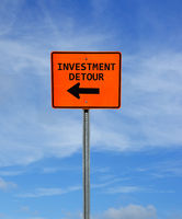 Investment Detour construction sign with arrow and blue sky -- retirement and investing concept