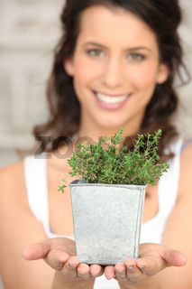 Young woman with thyme