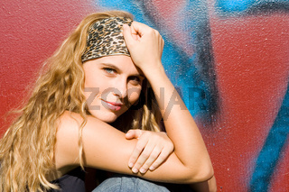 beautiful happy teen or young adult with long blonde, curly hair.