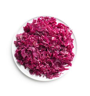 Red sauerkraut. Sour pickled cabbage on plate