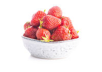 Whole ripe red strawberries in bowl.