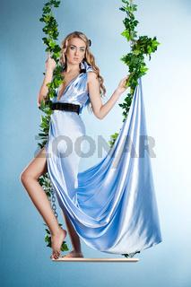 elegant fashionable woman on a swing