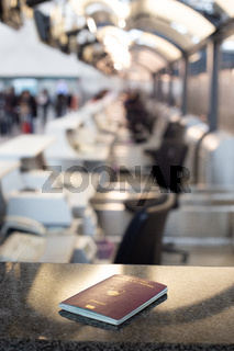 Slovenian passport vaiting for inspection on airport bording crossing check.Travel concept.