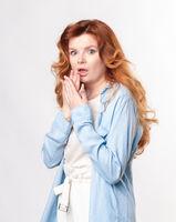 Shocked red-hair Model posing in studio