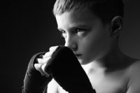 The young boy the boxer trains blow in strap