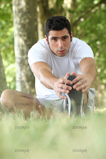 Man stretching in the forest